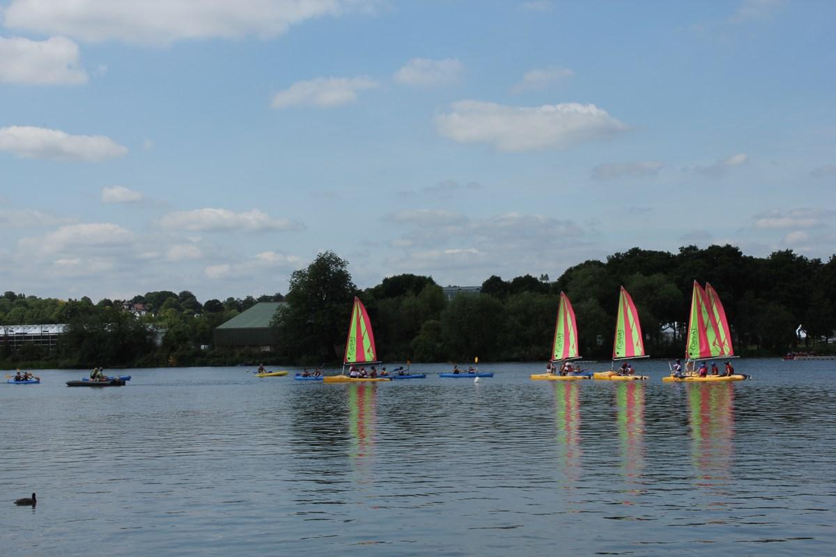 Boats sailing on lake