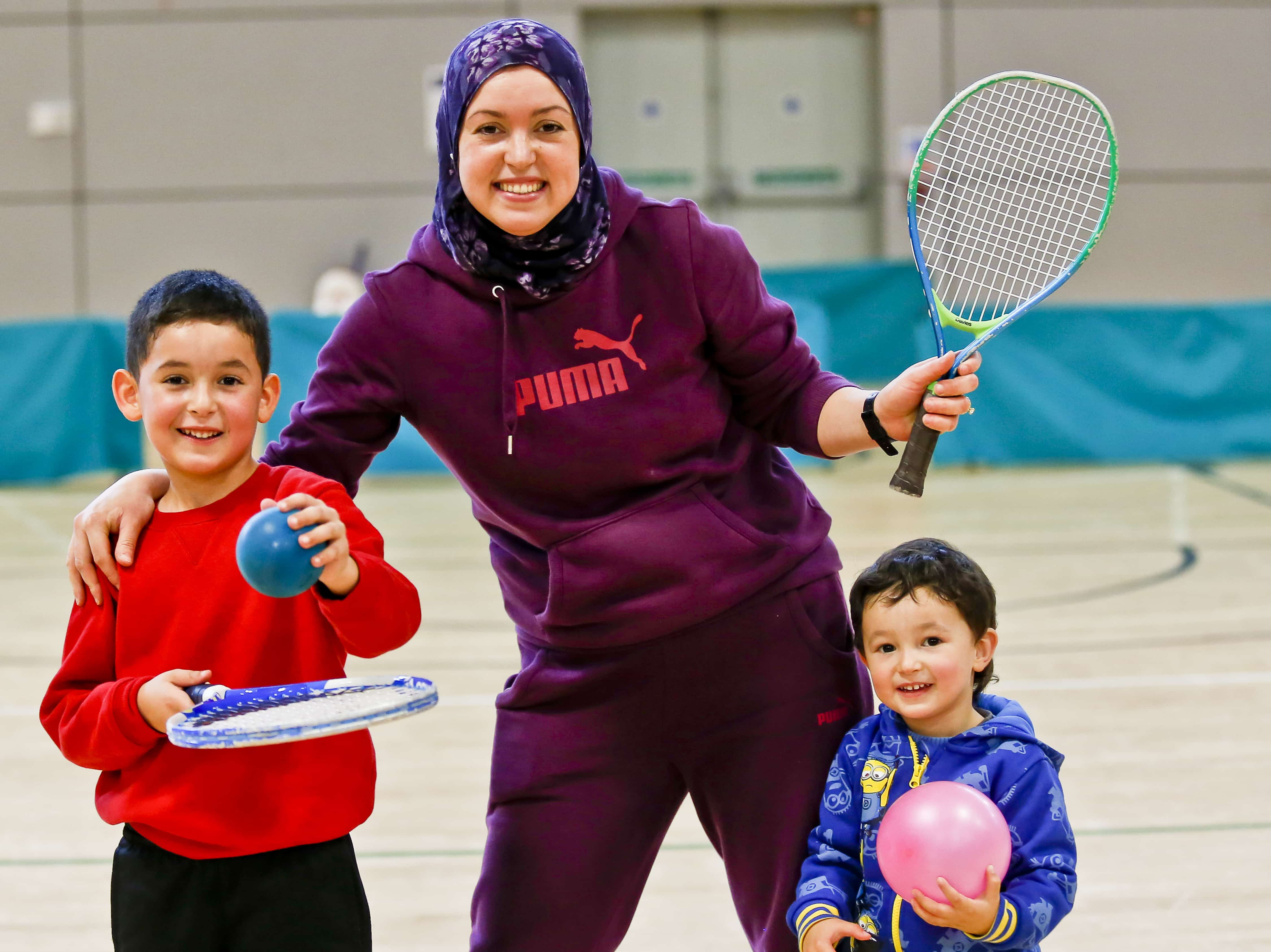 mum and two children joining in activity session