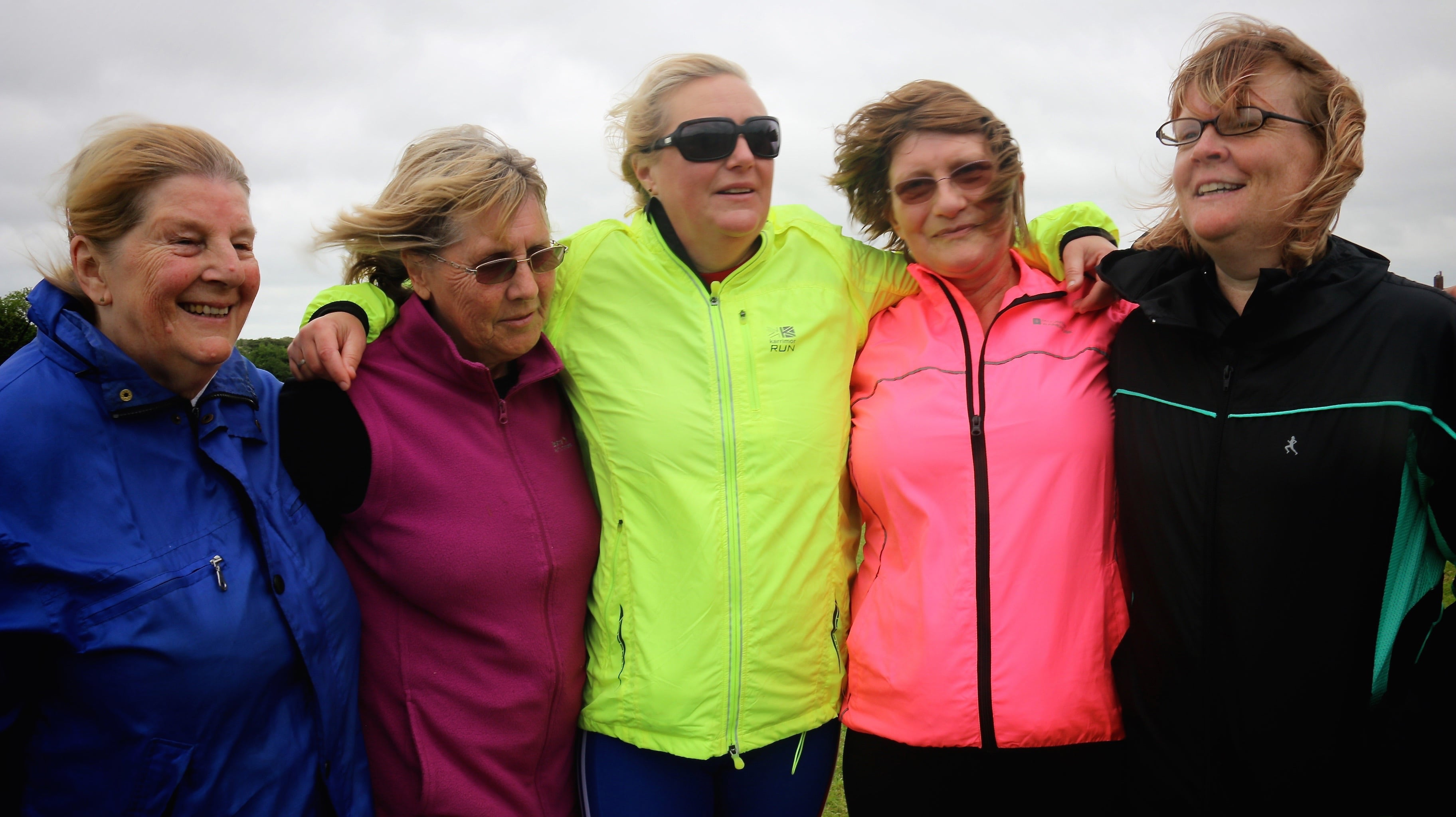 five females enjoying exercising outside