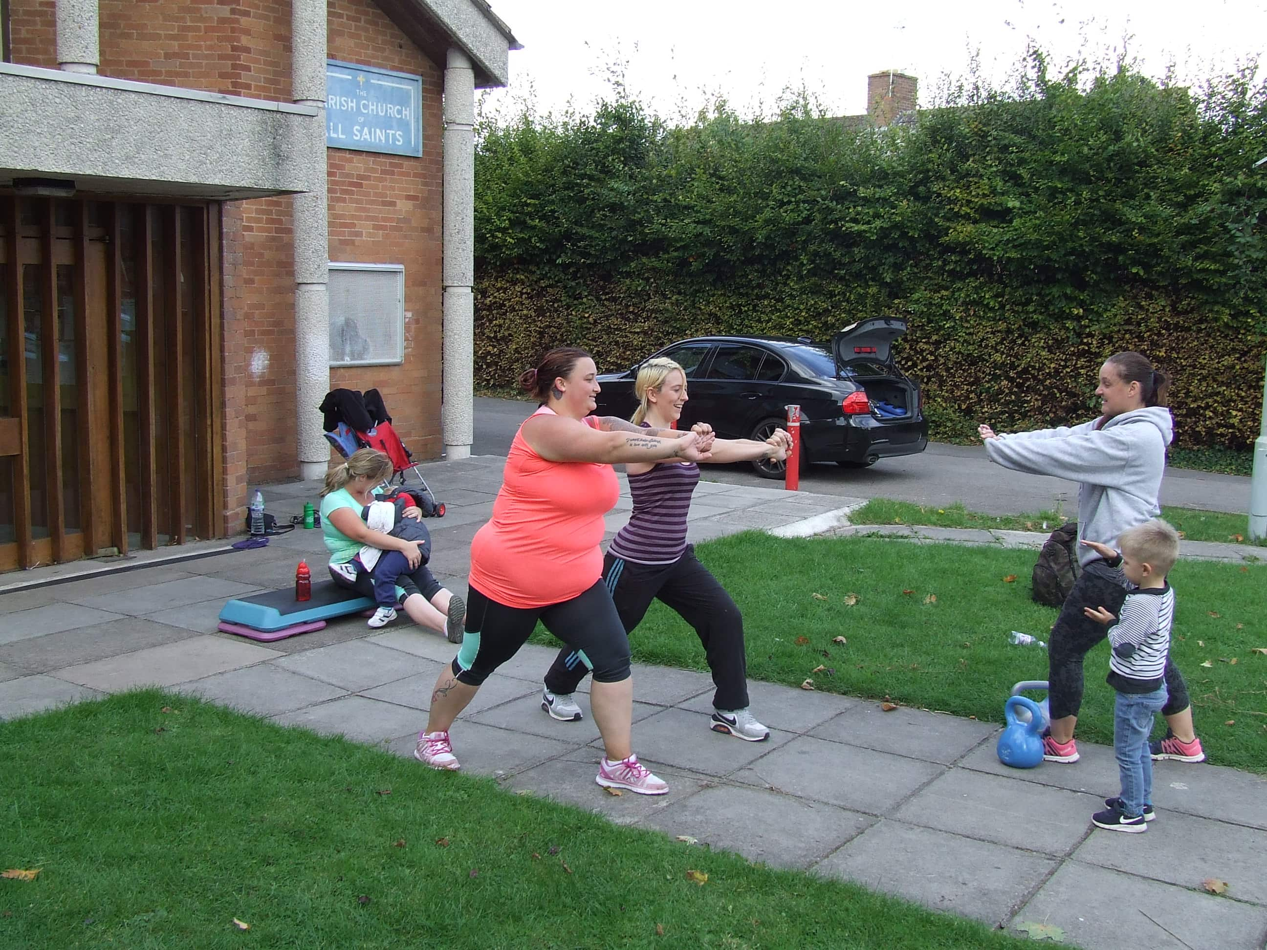 females undertaking circuit class outside