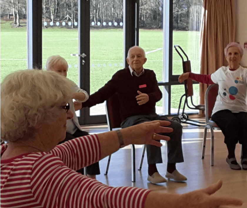 people taking part in arm chair dance sessions