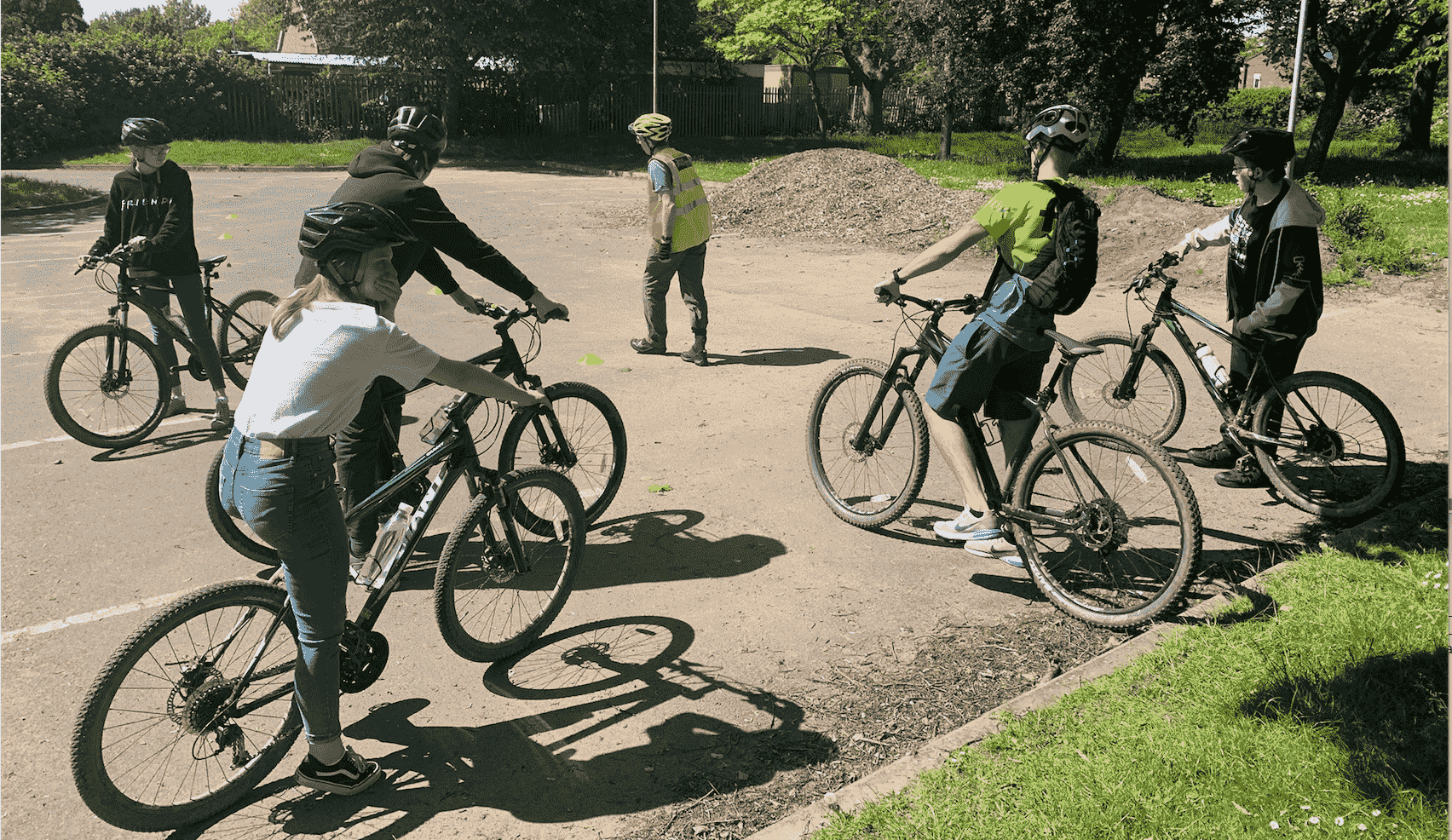 group of cyclists being taught some skills