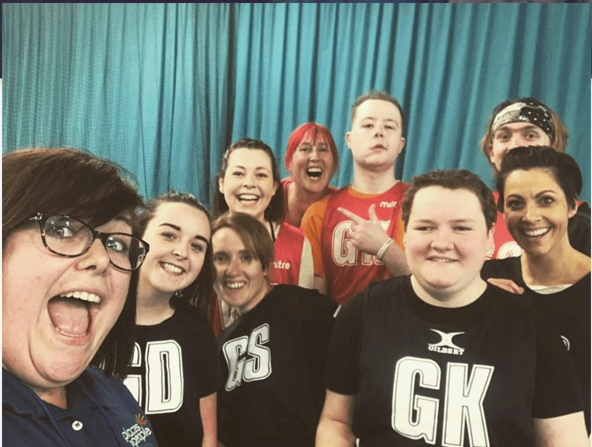 netball volunteers with players taking a selfie