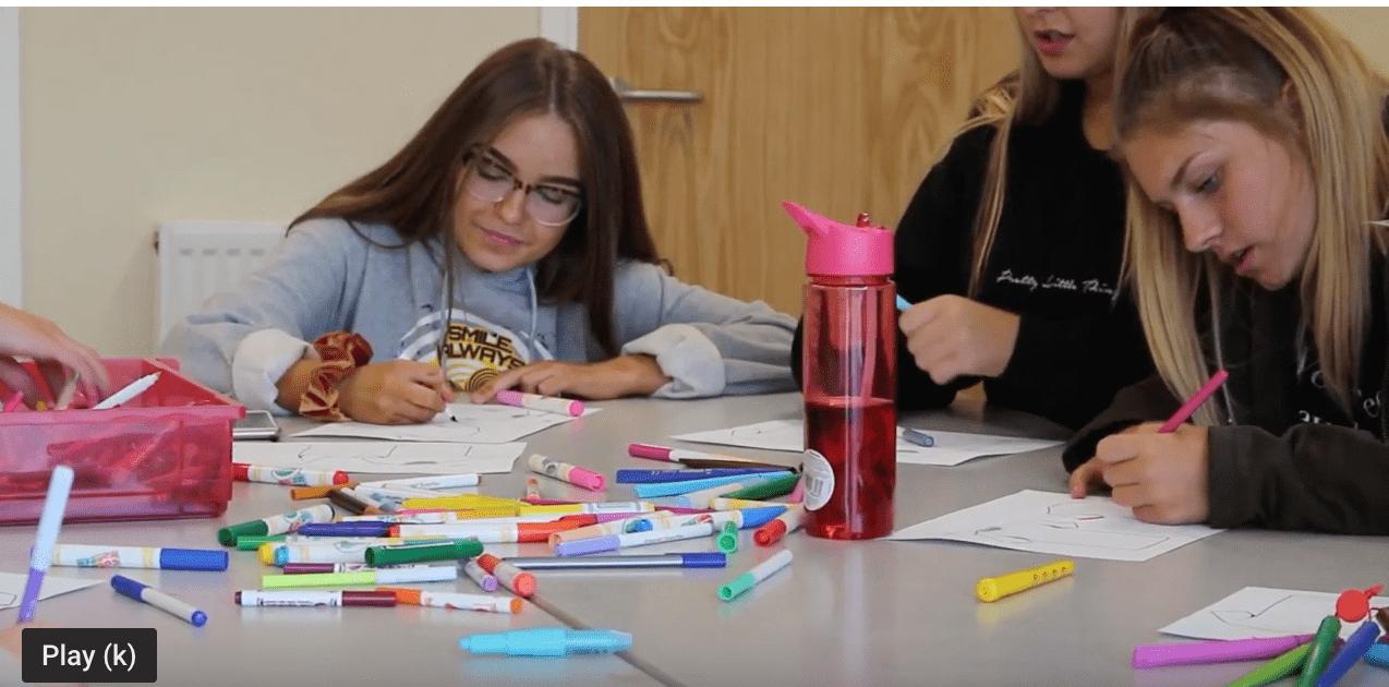 Girls at a table designing kit