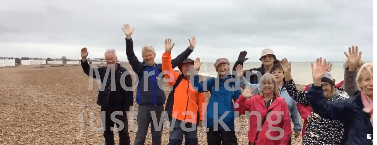 Group shot of walkers on the beach