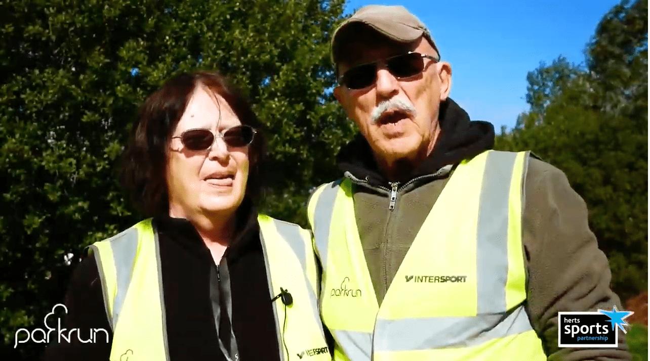 Two people enjoying volunteering at Park Run