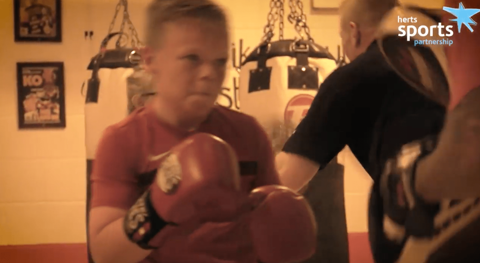 child taking part in boxing session