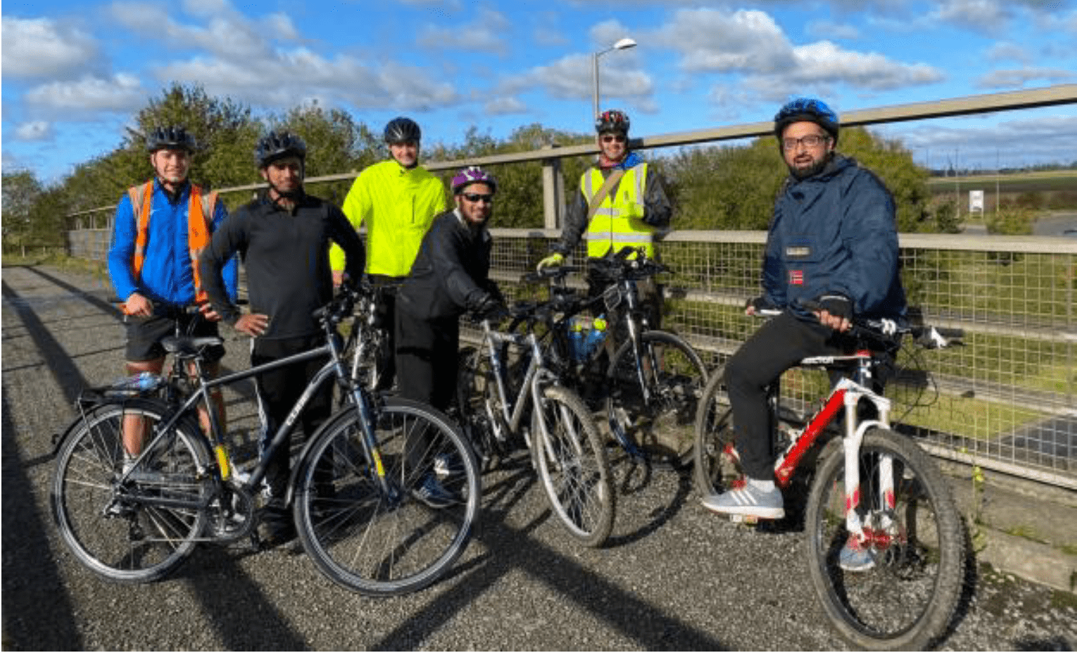 Group of cyclists from the project stopped on a bridge during group ride