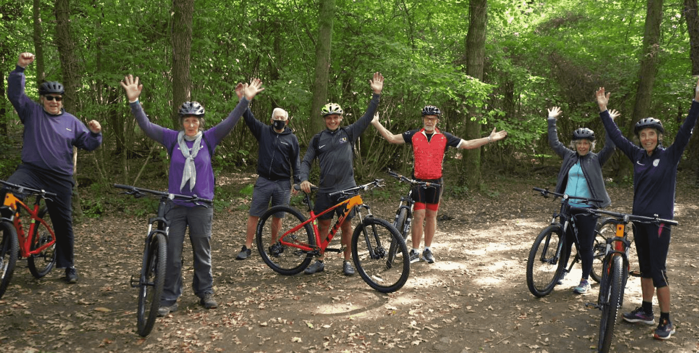 people socially distanced on bikes in a forest
