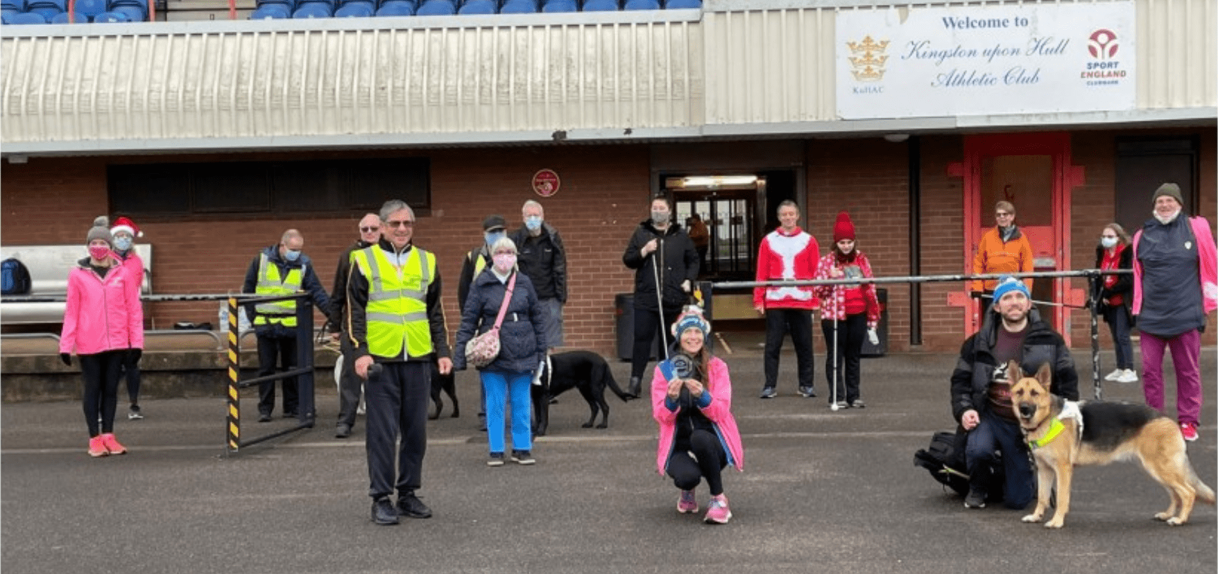 group picture of people with their guide dogs and walking canes
