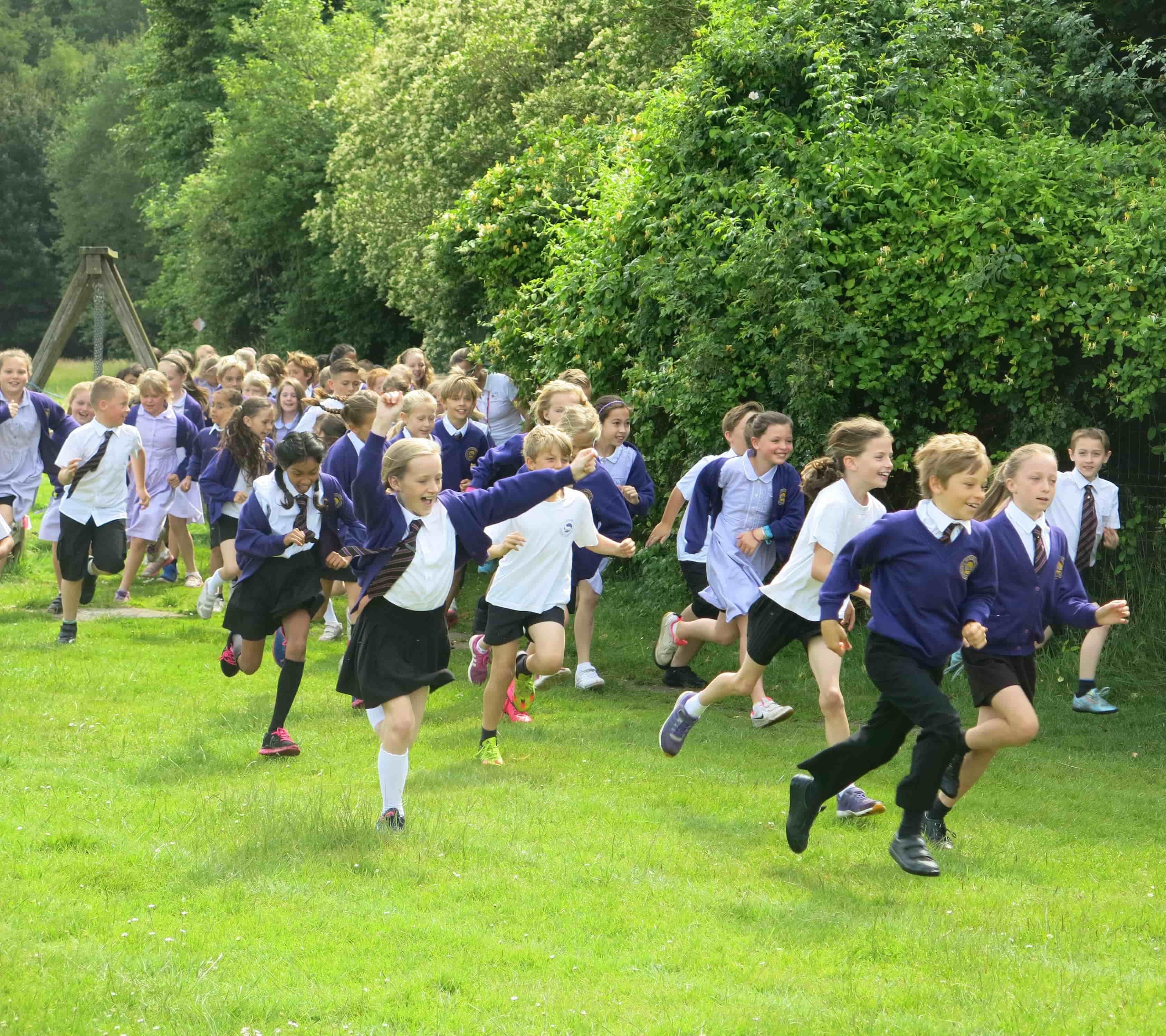Children enjoying running around school field