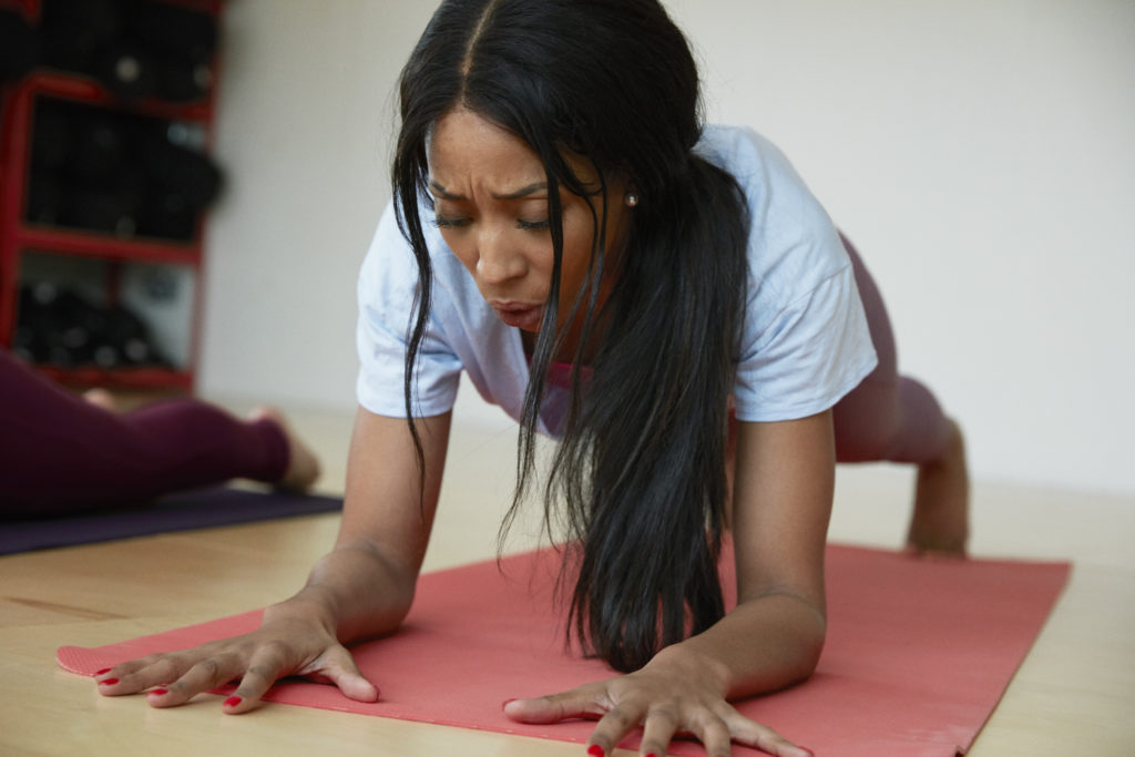 female doing yoga inside