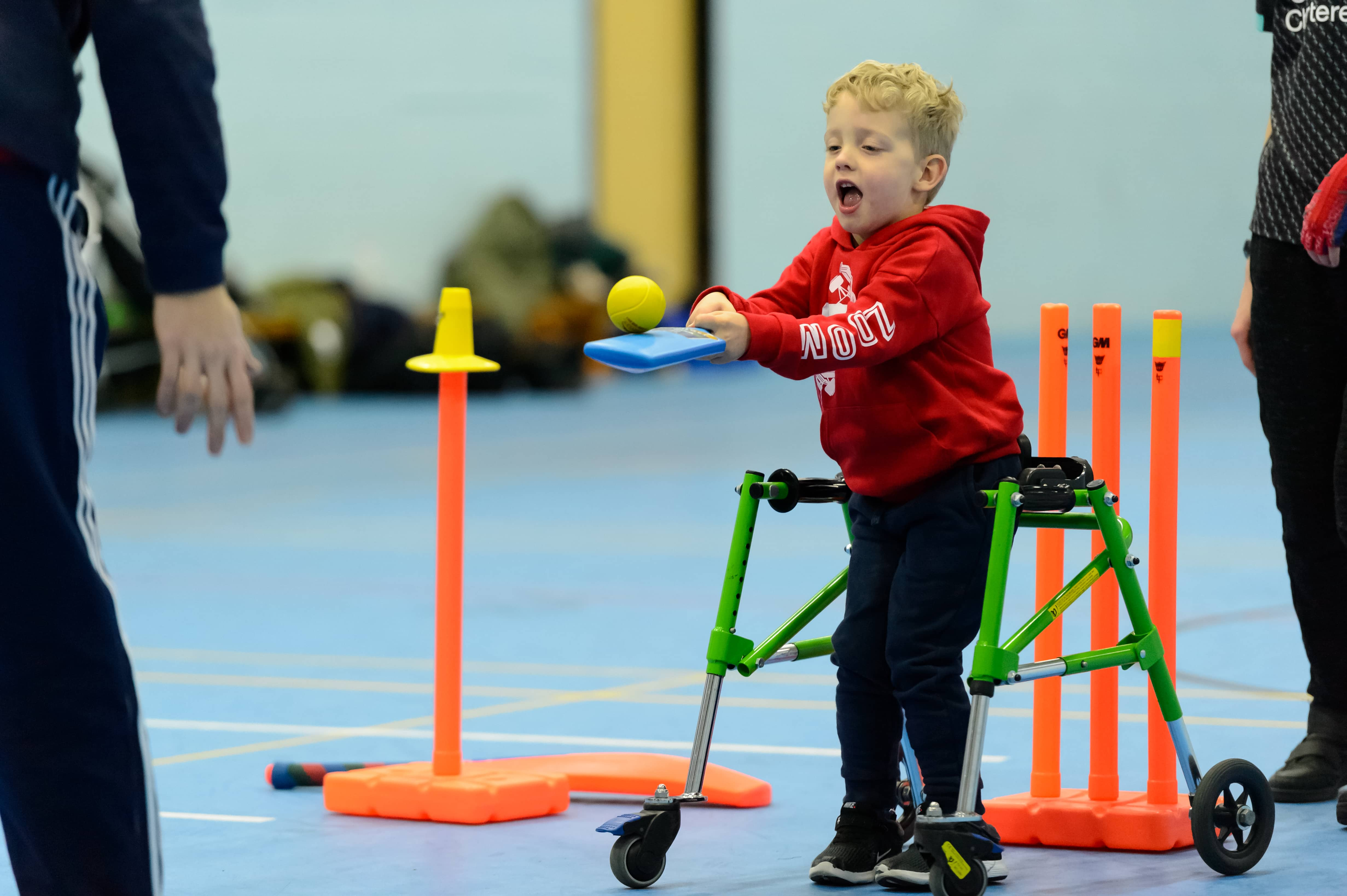 young disabled boy playing indoor cricket