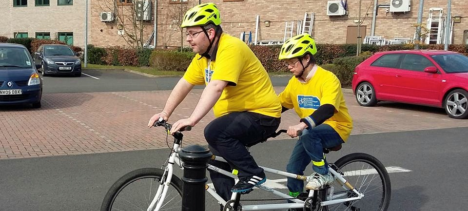 Ben and son cycling on a tandem