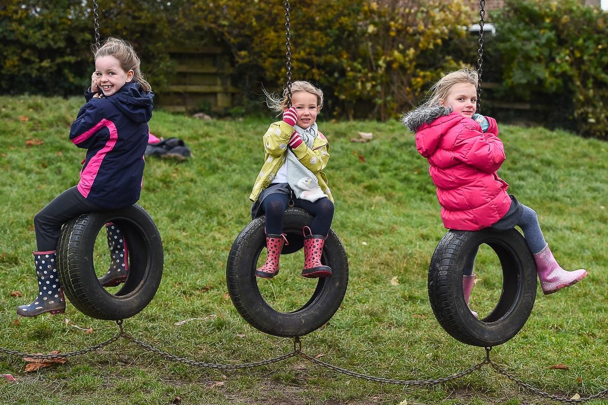 An image of three schoolgirls from Thorner Primary School in Leeds.