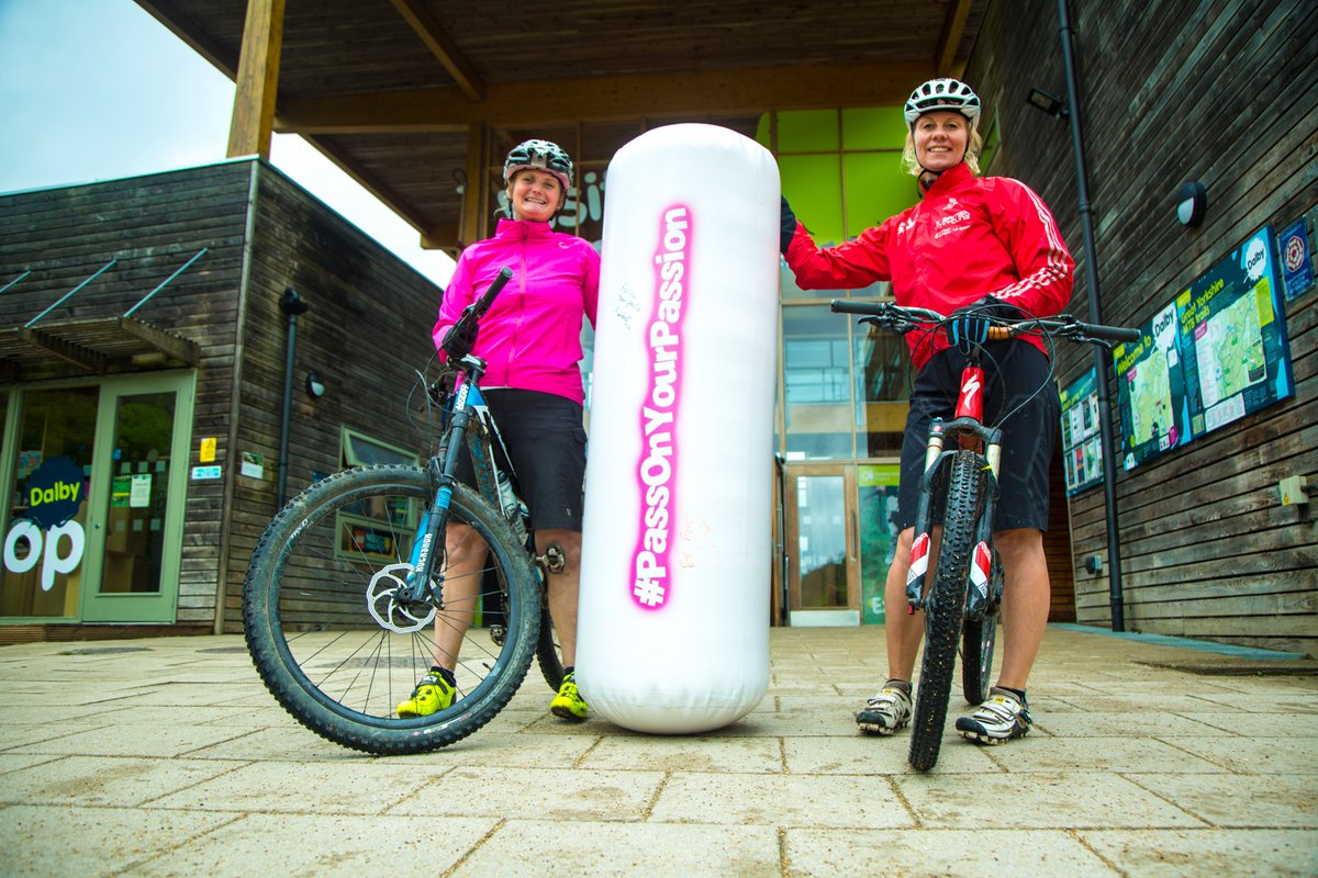 Two mountain bike coaches with inflatable baton