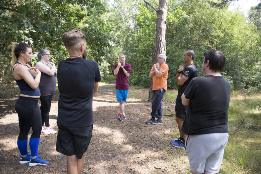 group exercising in woods