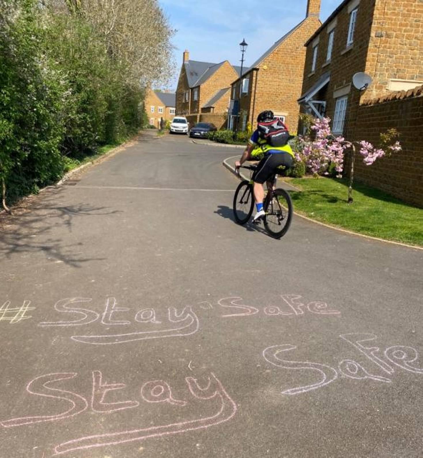 person cycling to deliver prescriptions