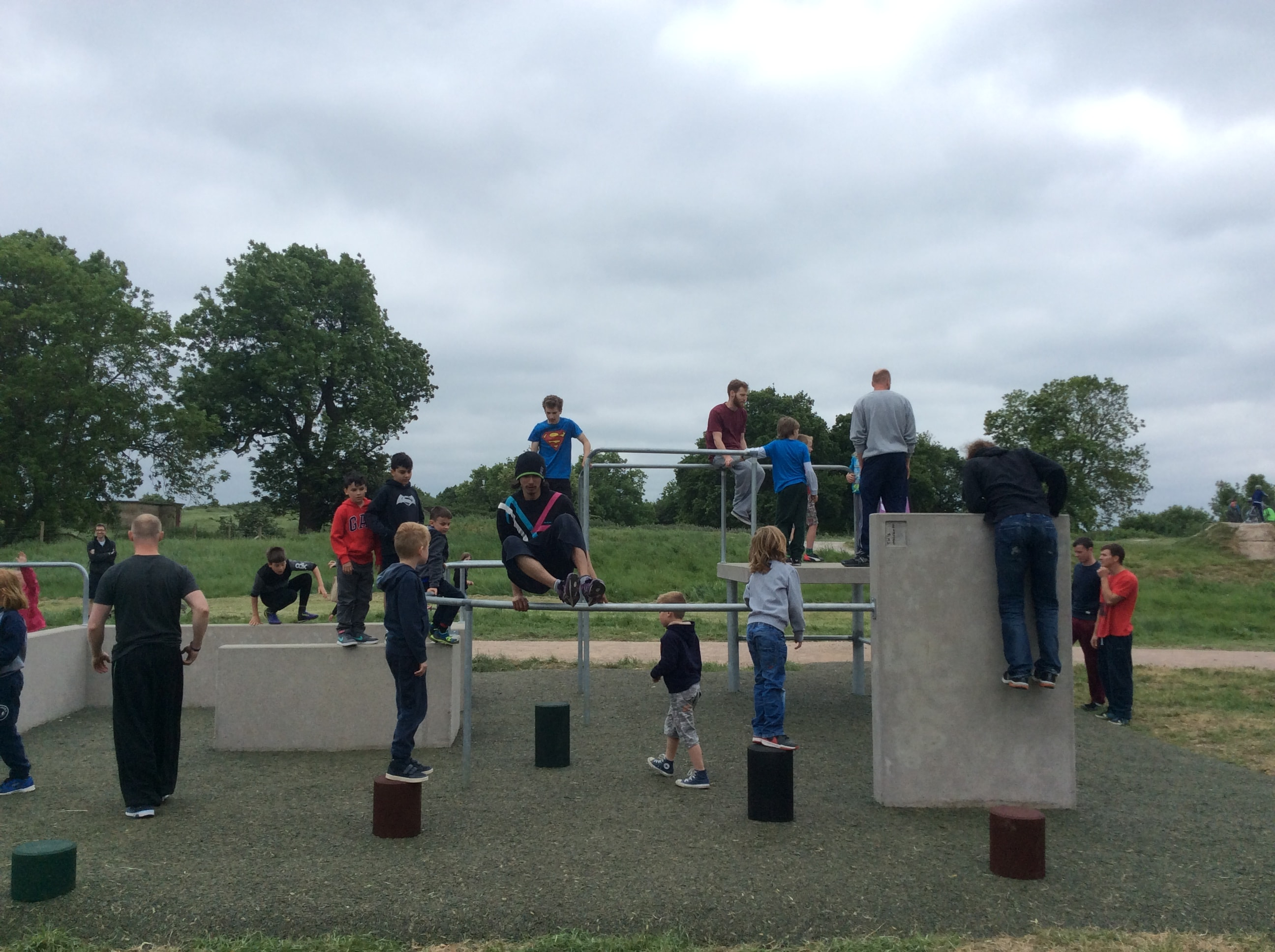 Children learn how to navigate the parkour obstacles at Hadleigh Park