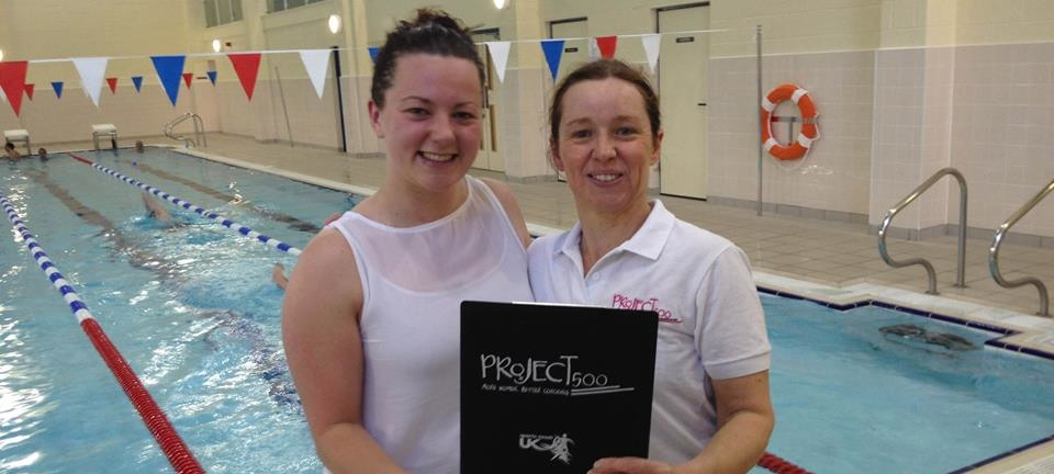 female swimming coaches standing by pool