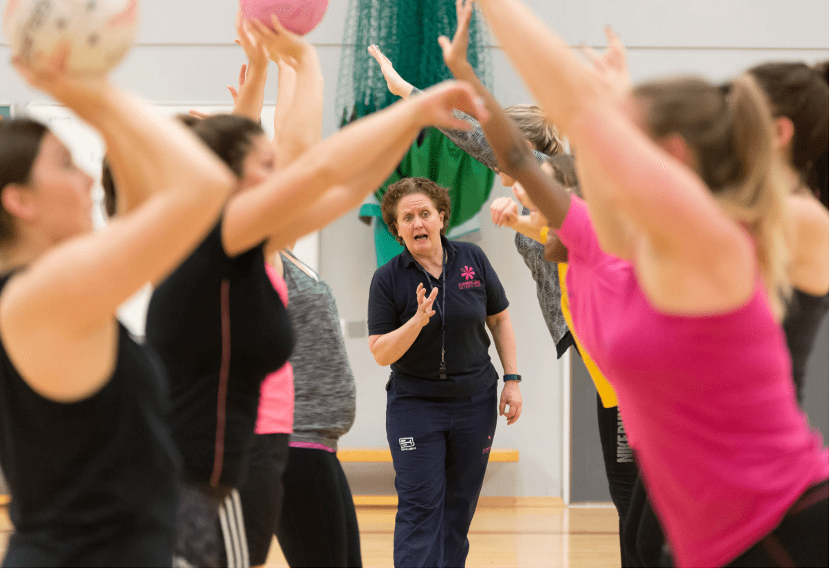 Female coach leading a Netball session
