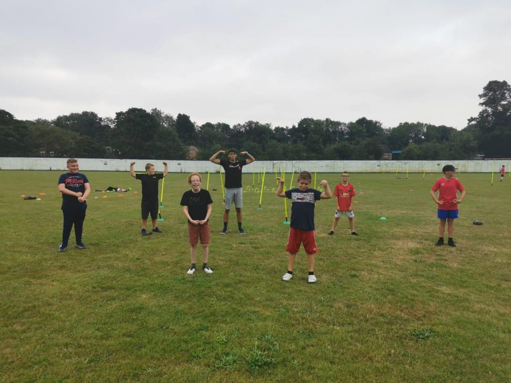 young people taking part in activity session in park