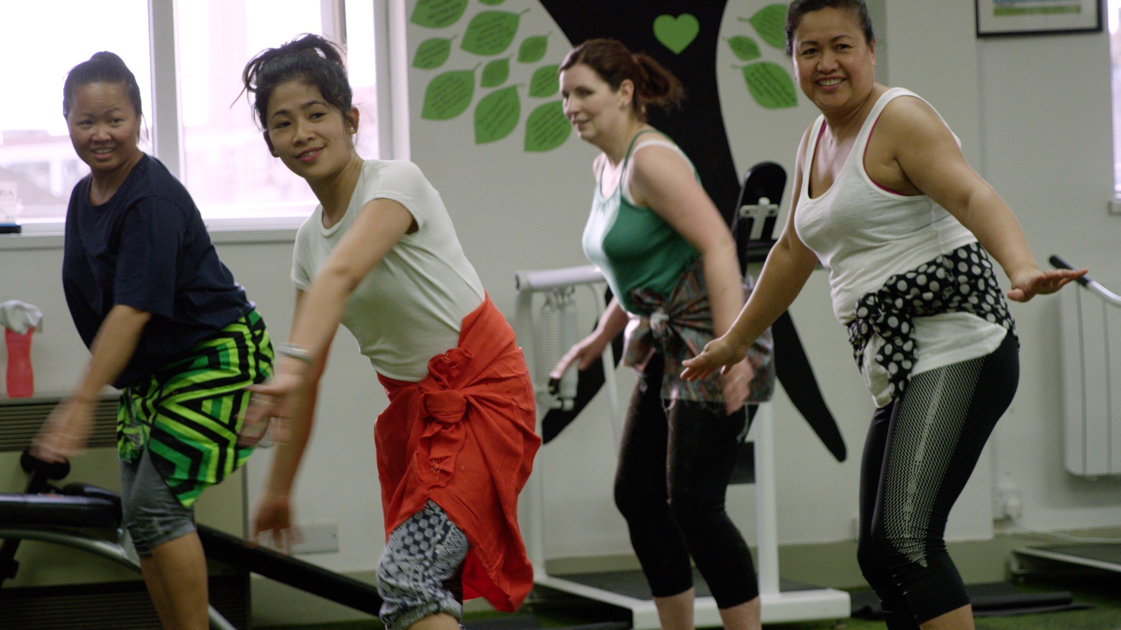 women having fun in an exercise class