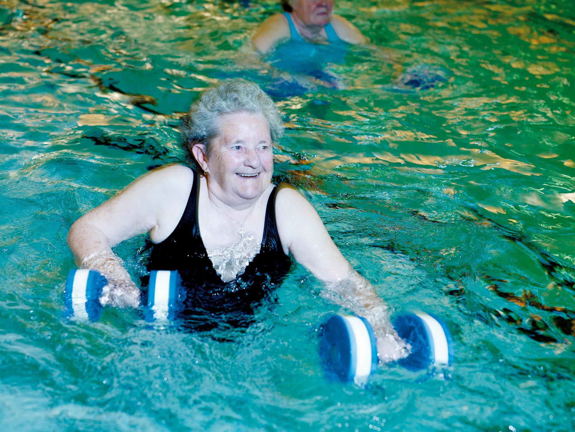 older female taking part in aqua fit