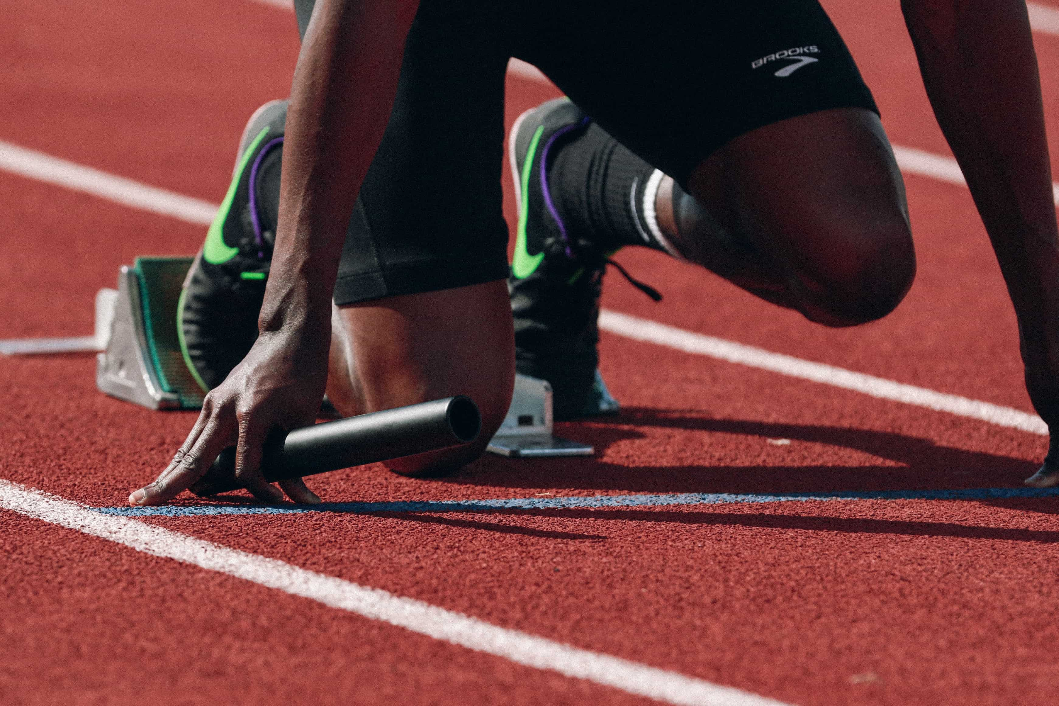 Black athlete in starting blocks