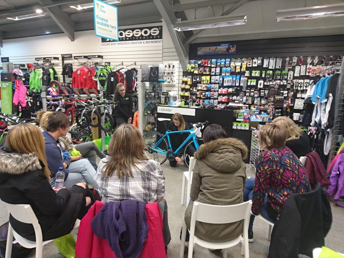 Women participating in bike maintenance workshop