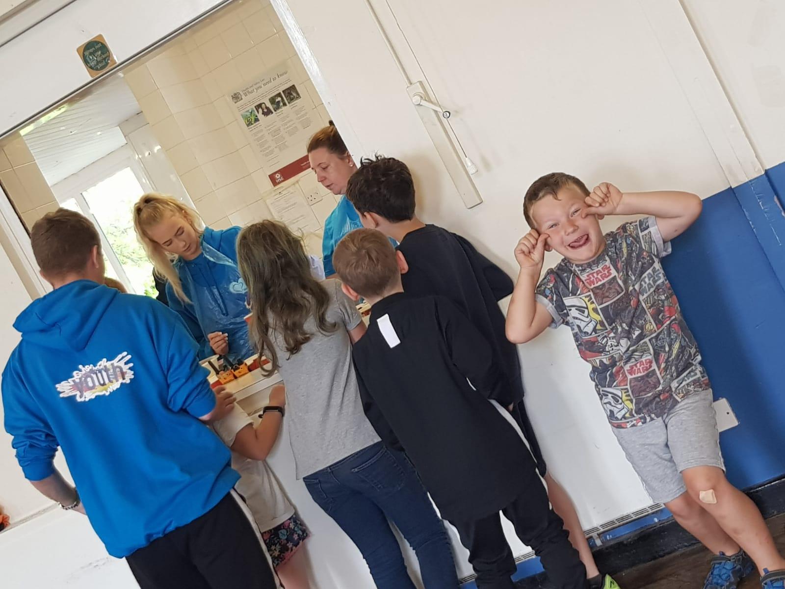 children being served food