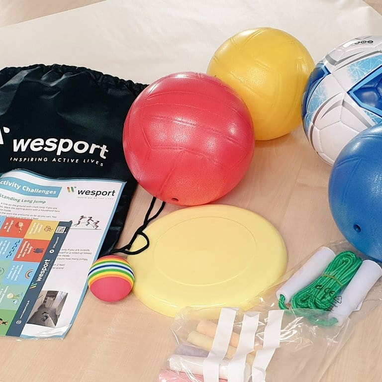 contents of activity bags including balls, activity cards