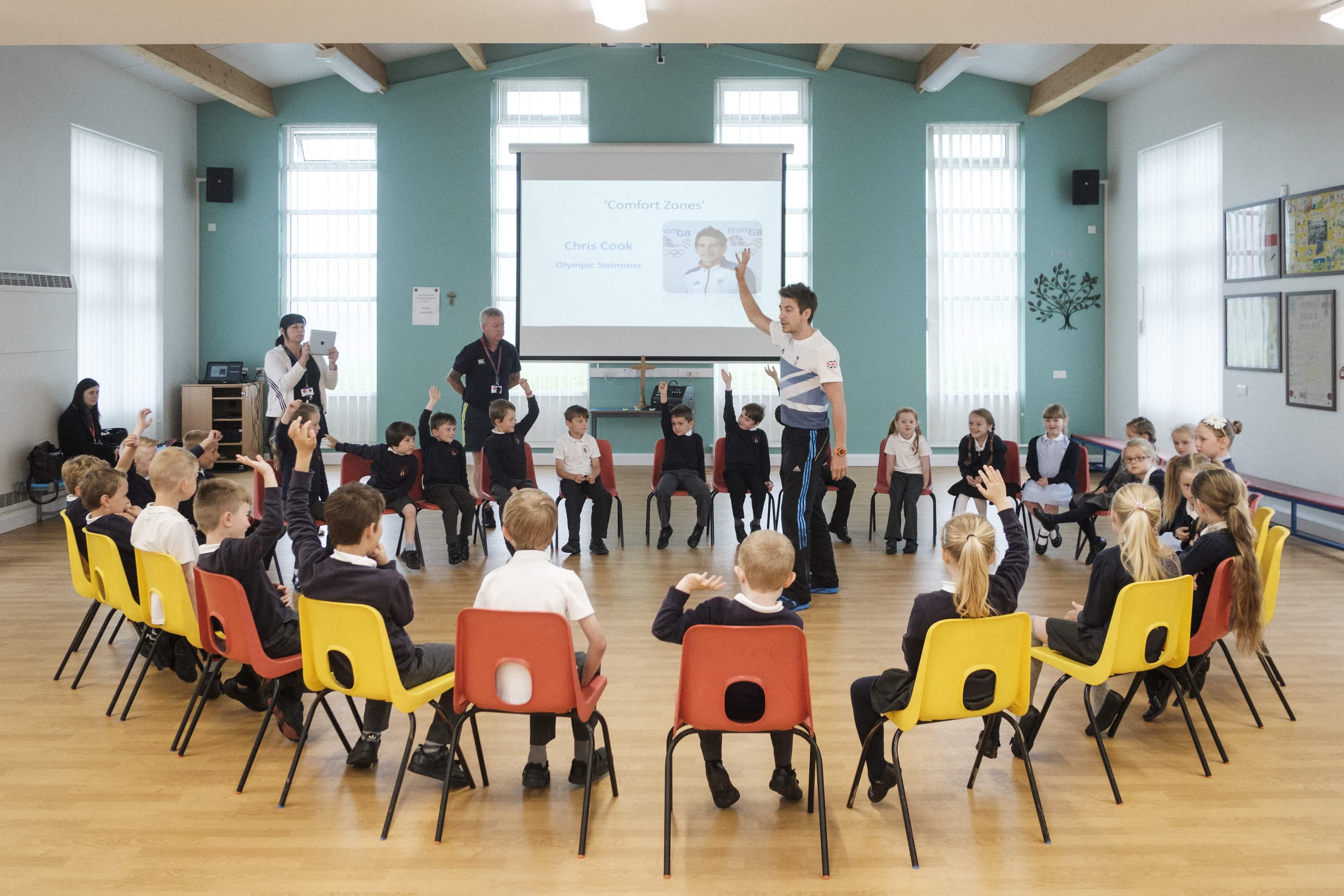 ex Olympian Chris Cooke inspiring a group of school children