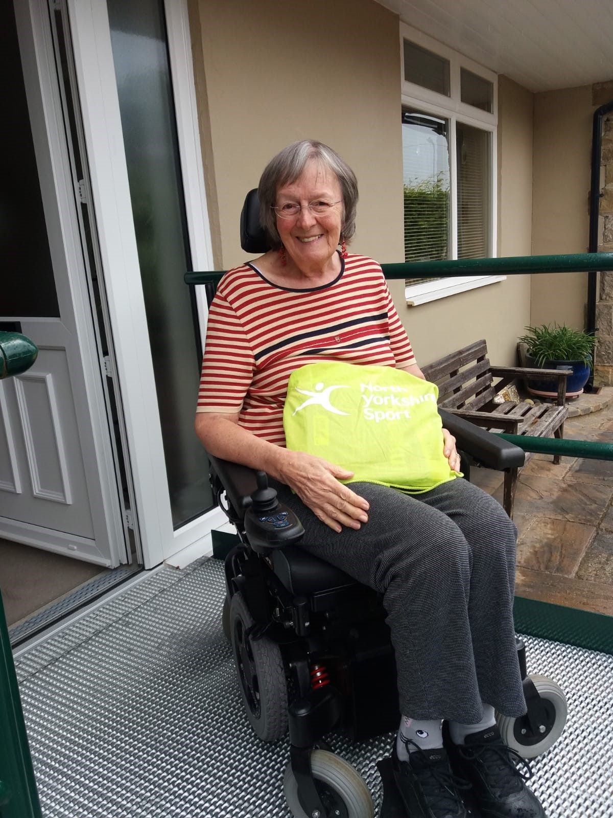 female wheelchair users holding her activity pack