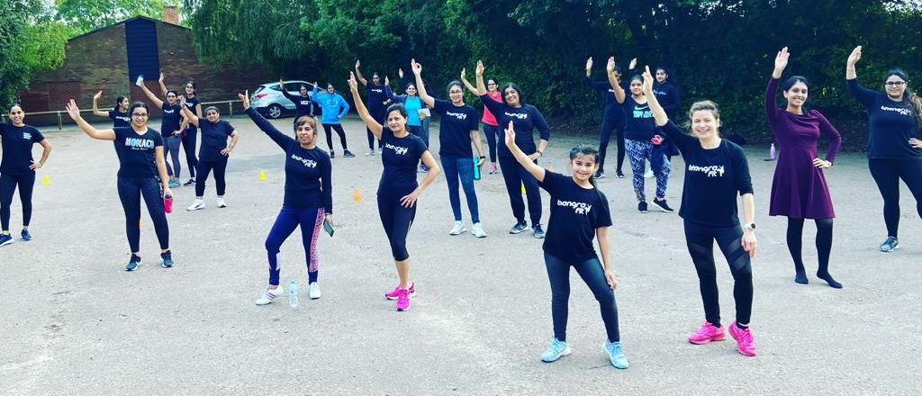 Group of social distanced women participating in Bhangra Fit sessions