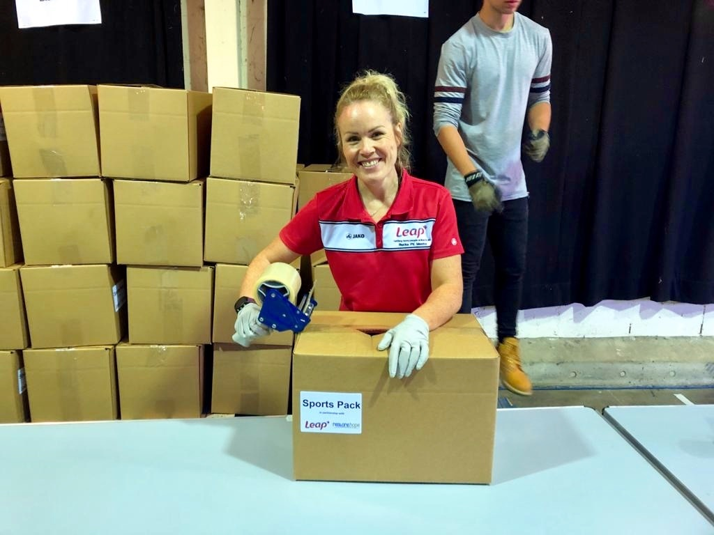 Leap member of staff packing boxes