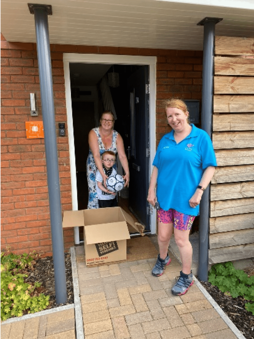 family having their activity pack delivered to their doorstep