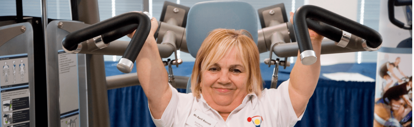 female disabled person using gym equipment