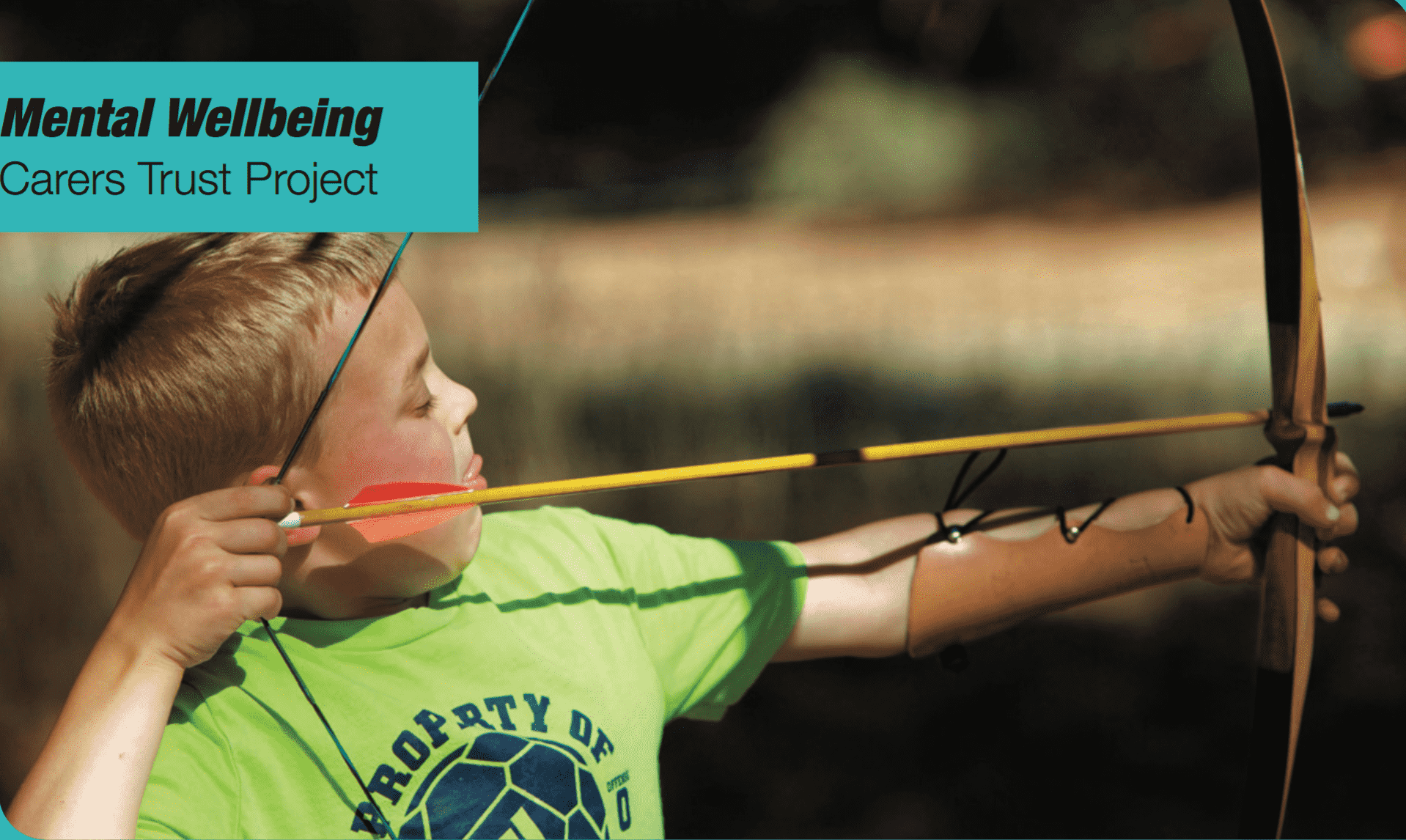 young boy having a go at archery
