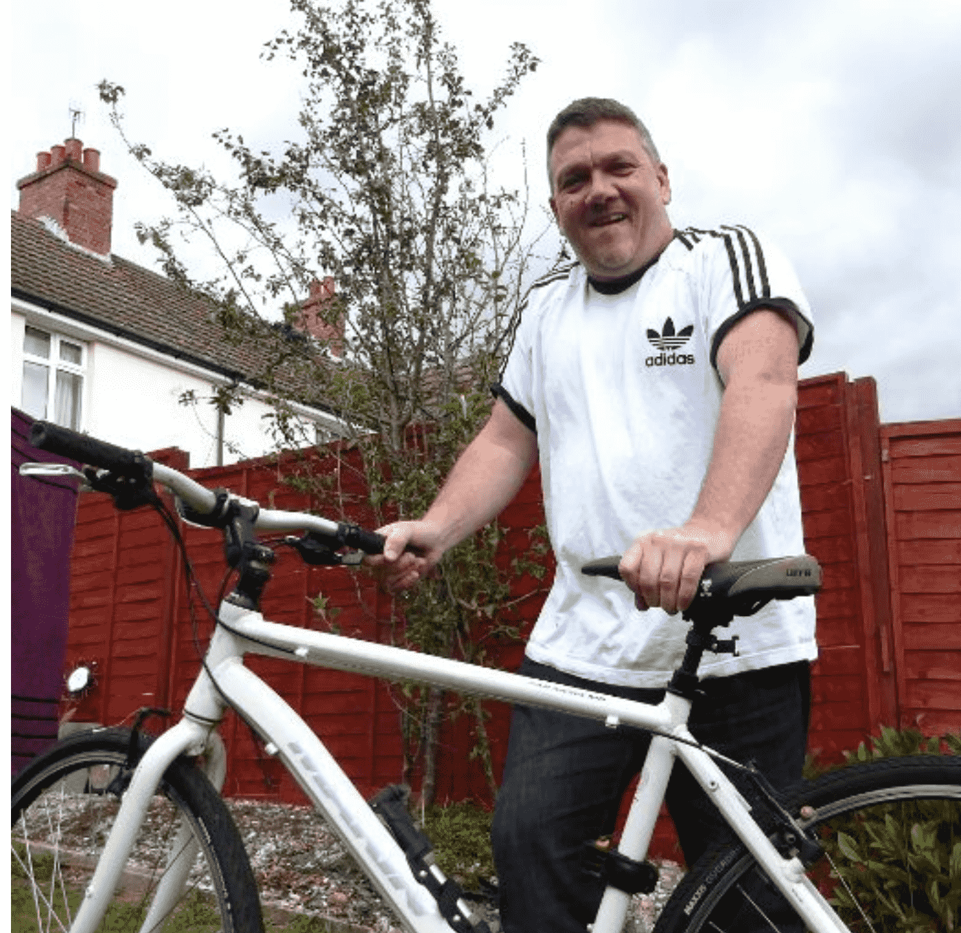 resident with his bike outside his house