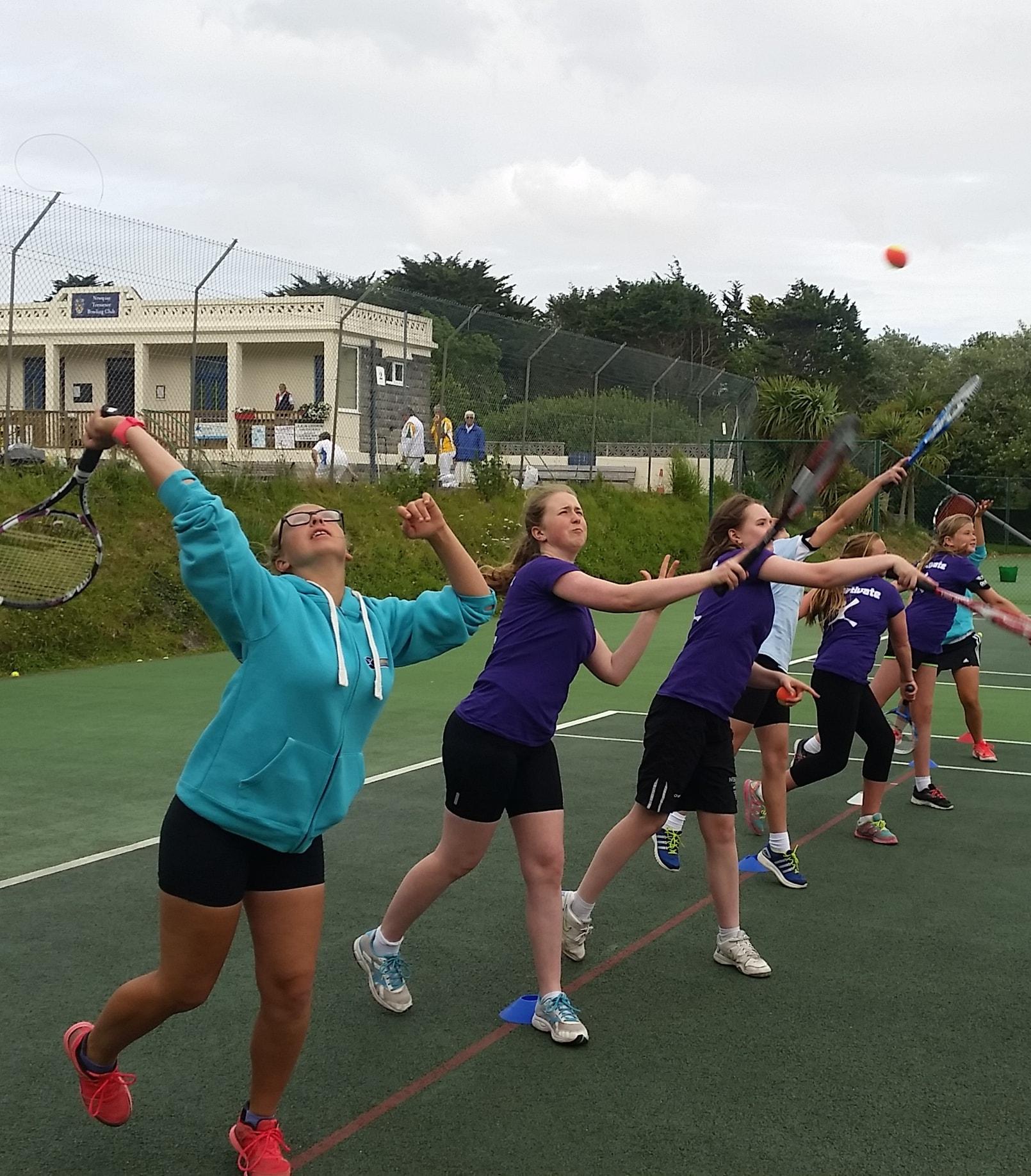 girls playing tennis