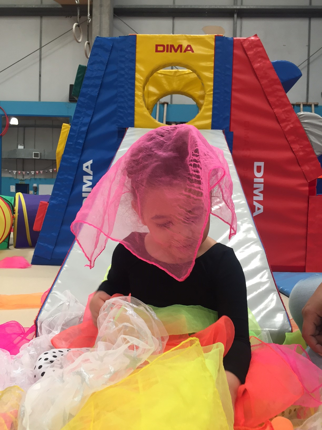 girl playing in soft play area