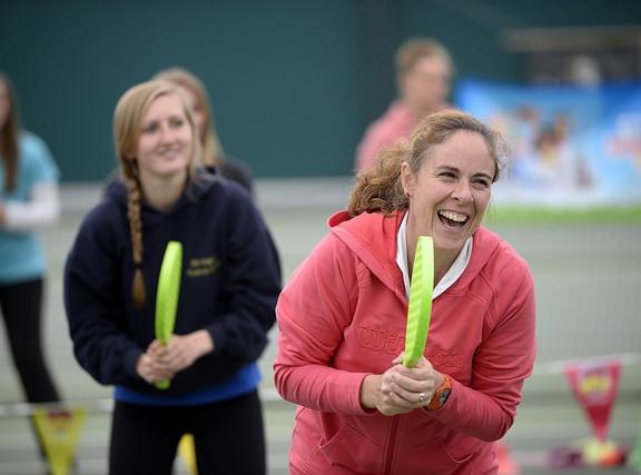 Two women enjoying playing tennis