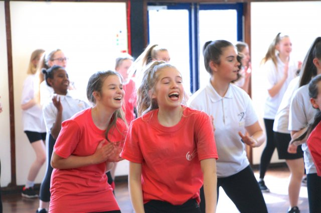 girls laughing whilst trying out activities