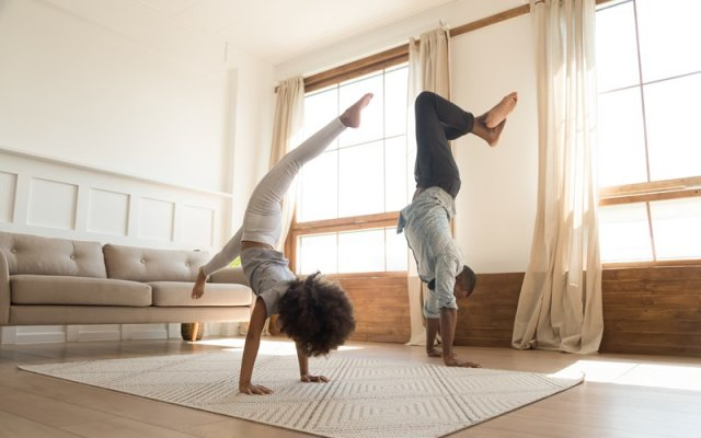 people doing yoga in front room