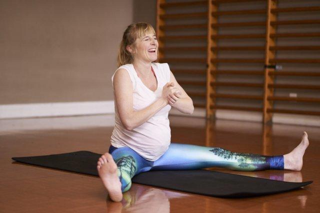pregnant person doing yoga