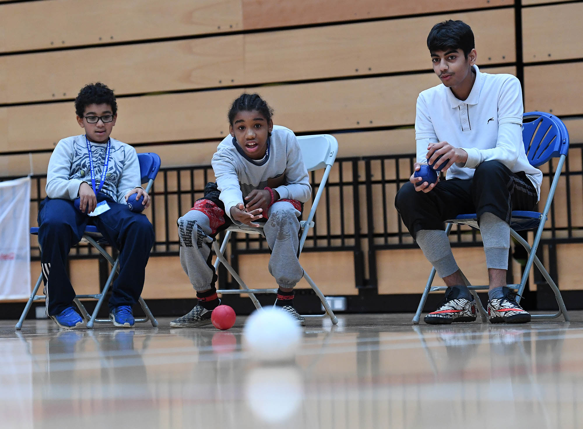 3 children playing Boccia