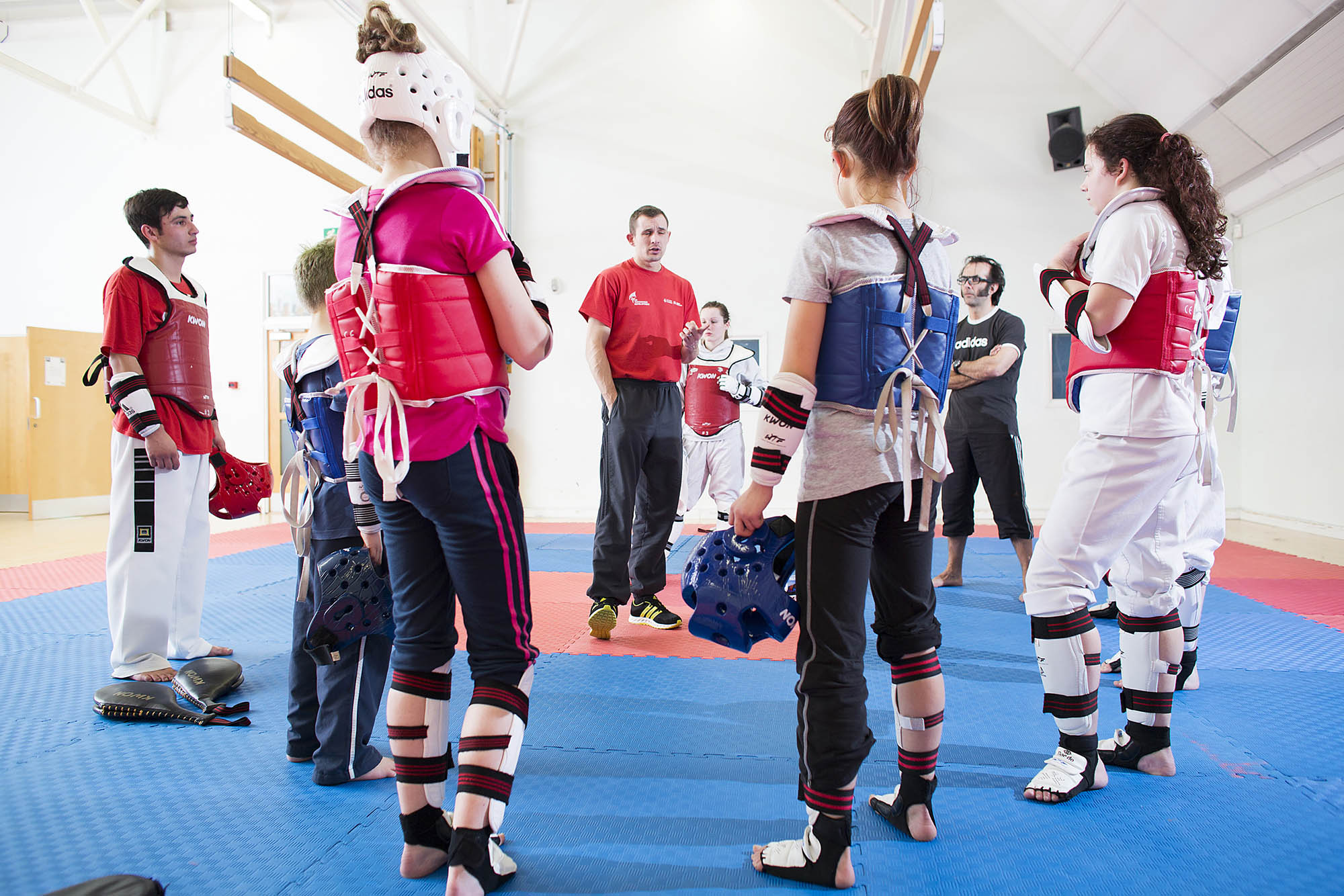 Taekwondo coach talking to group of participants