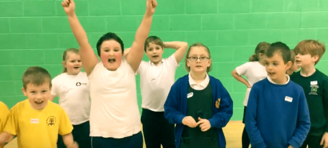 children cheering during activity session