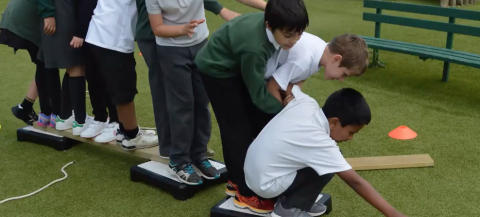 children taking part in active team building exercises